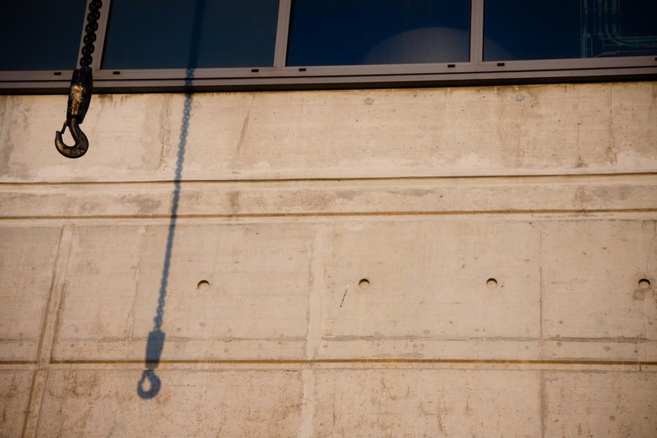 Crane shadow on industrial building